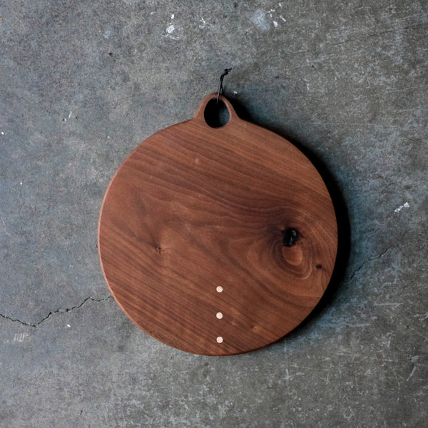 Handcrafted wood board from Brooklyn Two Tree Studios will provide a lifetime of use. Made of solid walnut with inlay of 3 maple dots.