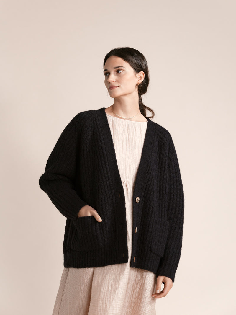 One of Hansel from Basel staple styles, the Darling cardigan.  Cozy, long sleeve, and oversized , it is made of soft alpaca and wool yarn. Button front, v-neck, raglan shoulder, and yes,  two pockets! It looks as lovely over jeans as it does over a more elegant dress such as the Beatrice dress by the same brand.