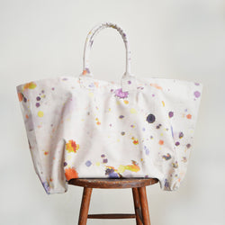 Martyn Thompson oversized canvas tote bag with paint splatter printed design. Carryall, extra large totebag available in Boston Shop. The newest version of our popular drop cloth canvas bag! Perfect for a day at the beach, a weekend getaway, or running about the city.
