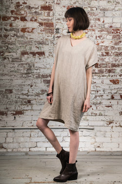 Simple, comfortable, oatmeal colored  v-neck shift dress made of 100% medium weight European linen, prewashed. 2 pockets in side seams.