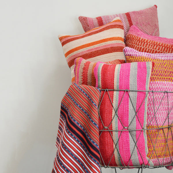 Made of vintage Peruvian blankets, these 100% wool pillows will add a pop of color to your living room. Buy a pair or mix and match for an eclectic touch. Each pillow is unique as it is cut from a vintage, handwoven blanket.  Organic dyes.