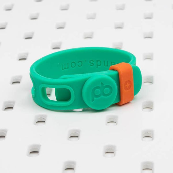 The small-size green Packbands SinglePack adjustable silicone storage strap  holds tool, small appliance and computer cords and cables