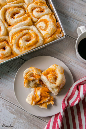 Fluffy, cheesy, and just the right amount of spicy, these Sriracha Cheese Swirl Buns are downright addictive! Make them as is or customize with flavor add-ons to your heart's delight