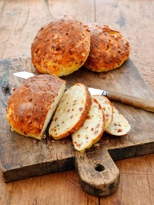 These sausage, ham, and cheese loaves are a hearty, traditional Portuguese bread, that is made with presunto, chouriço, and semi-firm sheep's milk cheese