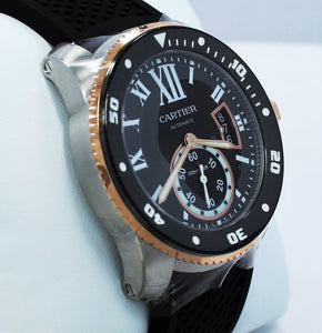 Cartier Calibre De Cartier Diver W7100055 42mm Automatic 18K Rose Gold *UNWORN* Details:   Make: Cartier Model: W7100055 Calibre Condition: Unworn  Includes: The Boxes & Papers  Movement: Automatic Material: Stainless Steel 18K Rose Gold Case Size: 42mm Crystal: Sapphire Crystal  Dial: Roman Numeral Black Dial Bezel:  Cartier Factory 18K Rose Gold Diamond Bezel  Bracelet:  Cartier Black Rubber Band Clasp: Tang Buckle  Crown : 18kt rose gold crown with a flush-mounted blue spinel cabochon.