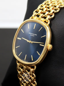 PATEK PHILIPPE Ellipse 3844 Circa 1980s 18k Yellow Gold Rare Collector's Watch  Make:PATEK PHILIPPE  Model: PATEK PHILIPPE Ellipse 3844  Movement: Manual movement  Material:  18k Yellow Gold  Case Size: 33mm Case thickness: 7mm Dial: Blue Bezel:  18k Yellow Gold  Bracelet: Patek Philippe 18k yellow gold Band, FULLY LINKED!  Fits up to a 8-8.25'' wrist.  No box/papers, will be shipped in a beautiful watch Box and Certified Appraisal. Archive papers can be ordered from Patek Philippe Directly  ,