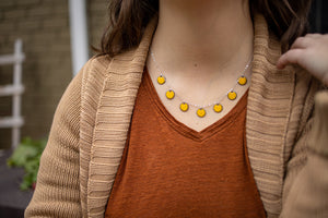 Marigold yellow enamel mini circle dangly necklace.  Photo by EGB Photography.