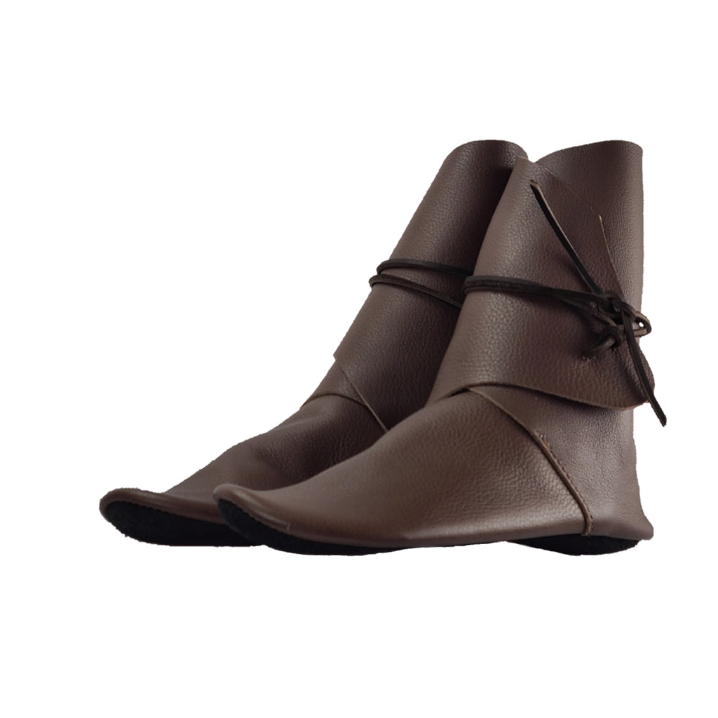 tall, shin-high moccasins for women in brown grained leather shown in angled view