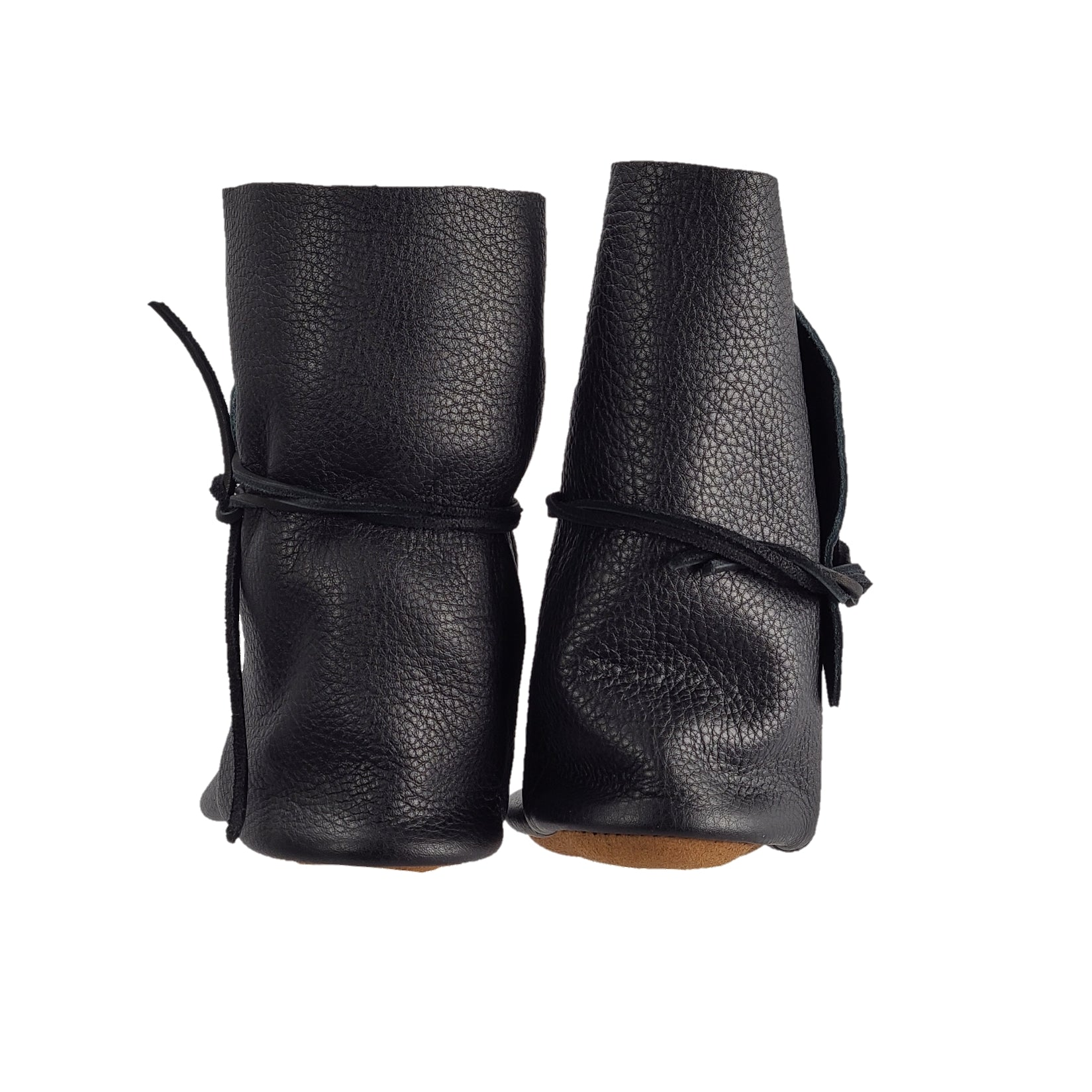 rear view of black jacket tackle company handmade moccasins in black for women
