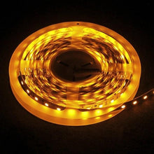 Load image into Gallery viewer, Environmental Lights Amber 5050 Single Row CurrentControl LED Strip Light, 60/m, 12mm wide, by the 6m Reel from OnSetLighting.com