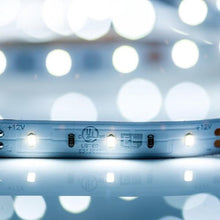 Load image into Gallery viewer, Environmental Lights Daylight White 2216 TruColor LED Strip Light, 60/m, 8mm wide, by the 5m Reel from OnSetLighting.com