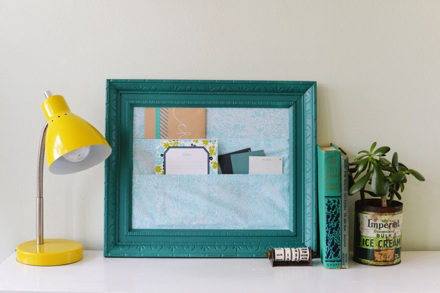 Keep your office or craft room nice and tidy with this chic organizer made of fabric and a repurposed frame