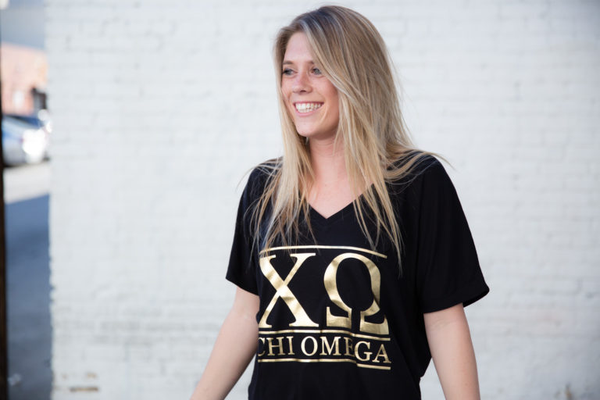 model wearing black t-shirt with foil Chi Omega graphics