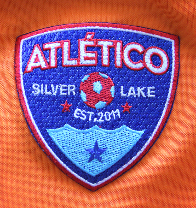 blue silver lake athletico patch on orange jersey
