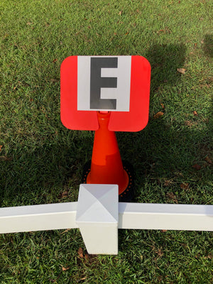 Adhesive Dressage Letters mounted to cone signs.
