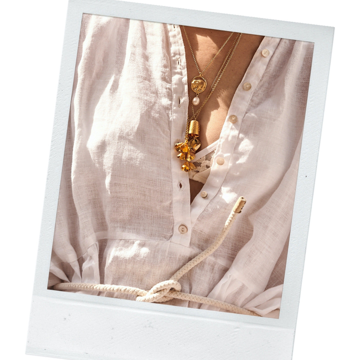 Women wearing Brave Edith gold necklaces on white shirt