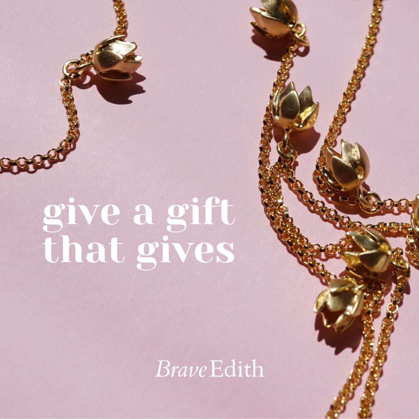 Give a gift that gives gold necklace on pink background