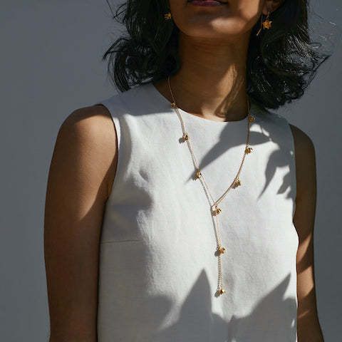 Woman wearing Bloom Lotus Lariat in Gold by Brave Edith
