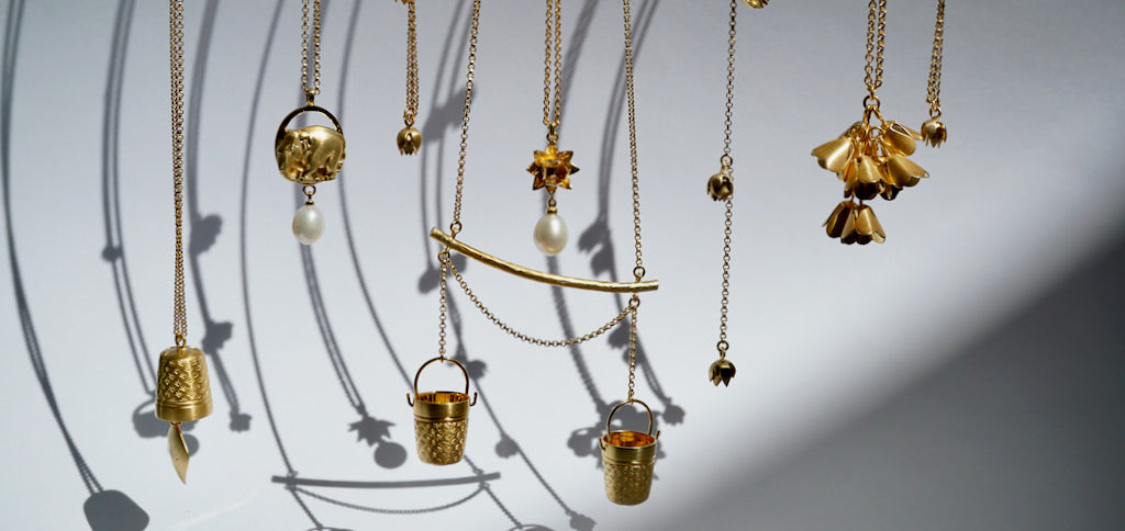 Collection of Gold necklaces by Brave Edith