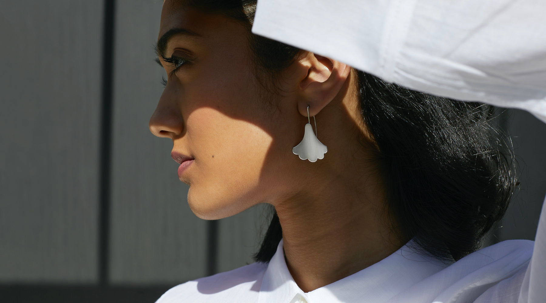Woman wearing Silver Plume Hook Earrings from Brave Edith