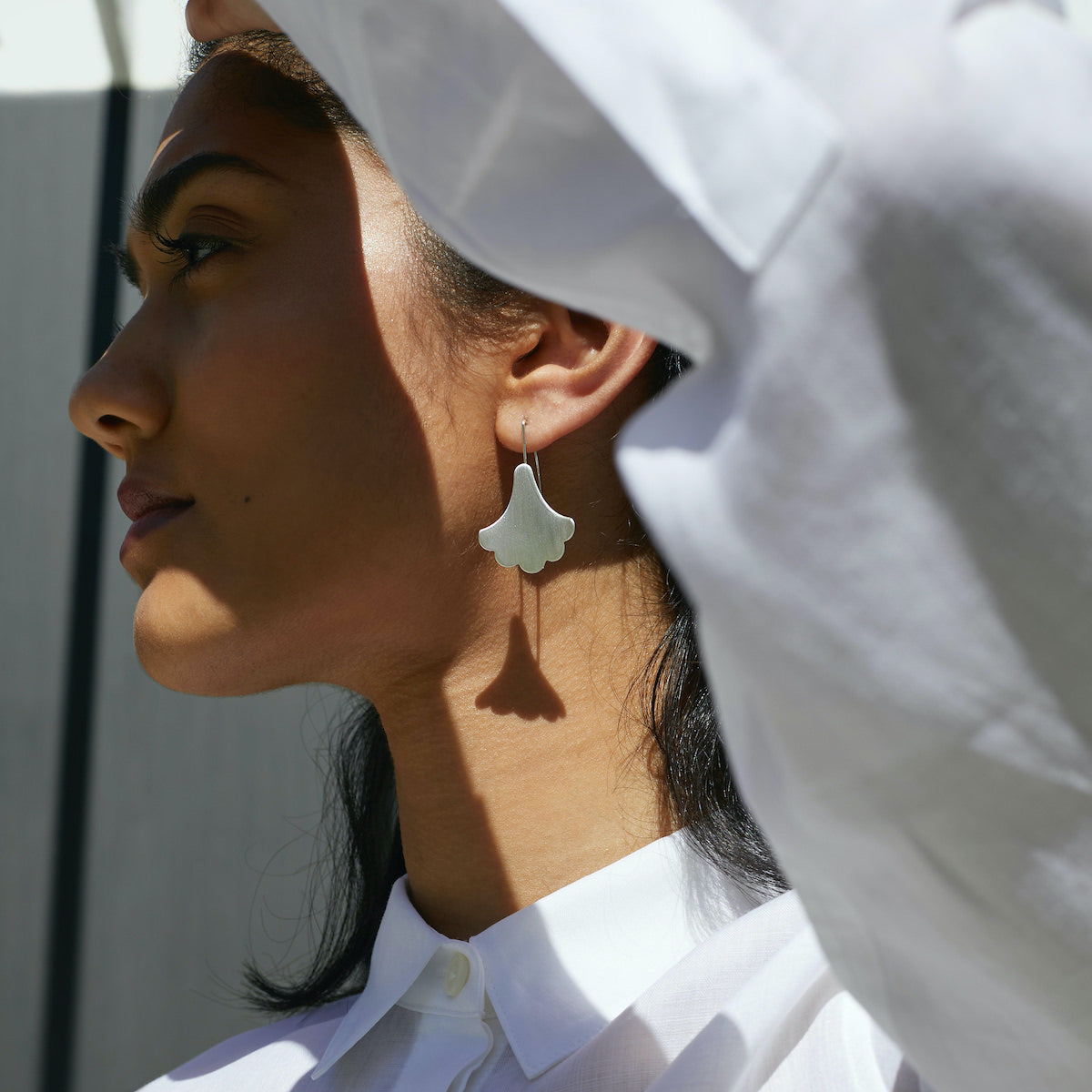 Woman wearing Silver Plume Hook Earrings by Brave Edith
