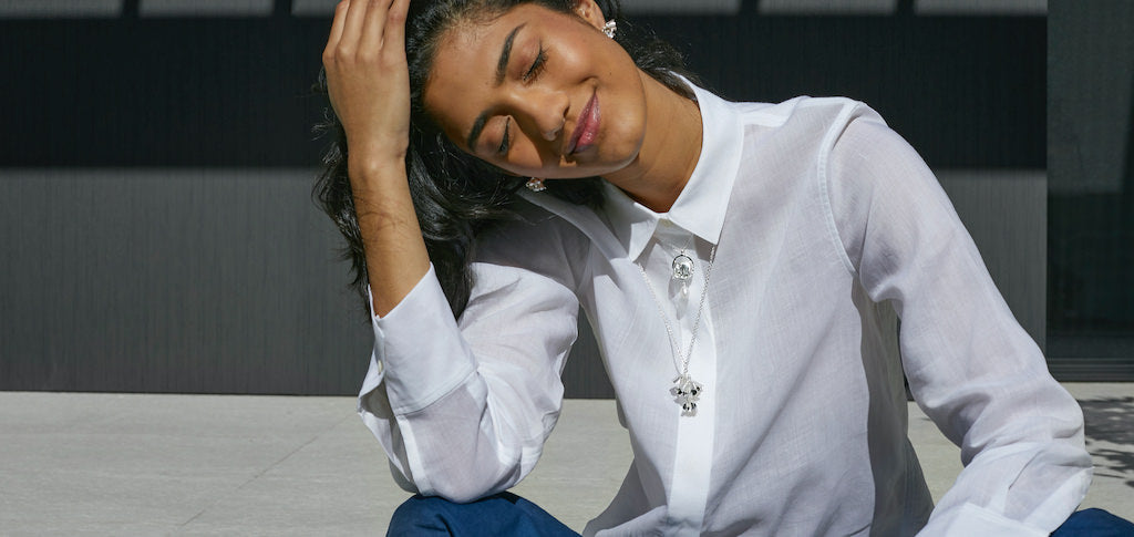Woman in white shirt wearing silver jewellery from Brave Edith