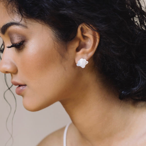 WOMAN WEARING BRAVE EDITH SILVER PLUME SINGLE FAN EARRING