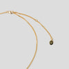 gold clasp of necklace on white background