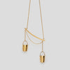 close up of gold precious buckets necklace on white background