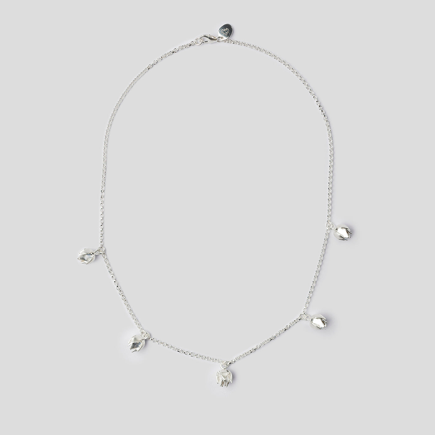silver lotus bud necklace on white background