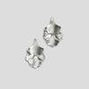 front of silver plume small fan earrings on white background