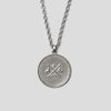back of Silver precious coin necklace on white background