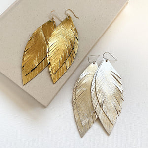 Large leather feather earrings available in silver or gold