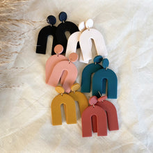 Load image into Gallery viewer, Polymer clay earrings handmade in southwestern colors like black, teal, terracotta, mustard and off-white