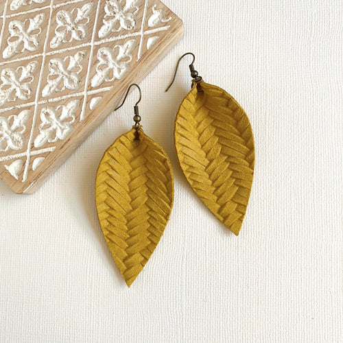 Yellow leather leaf earrings with braided texture