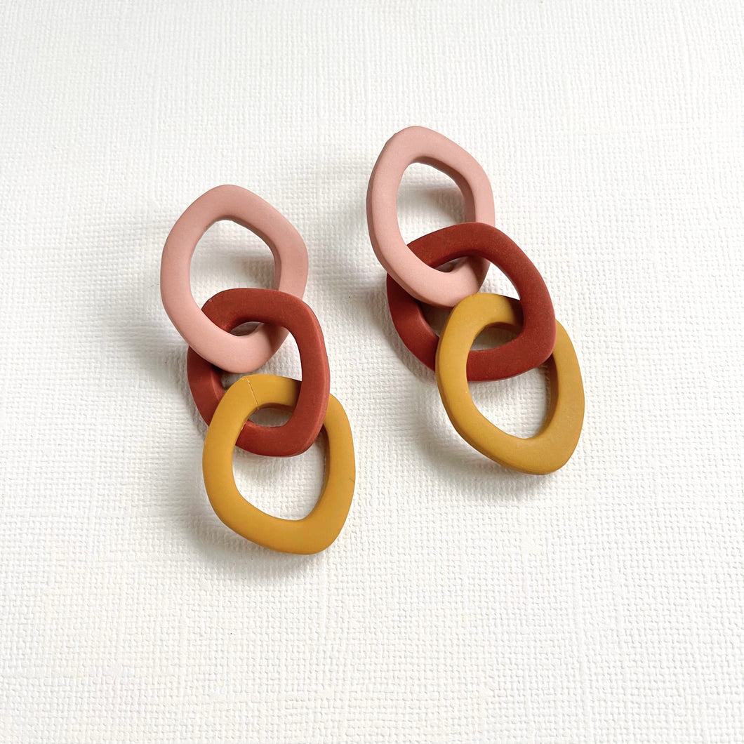 Clay chain earrings in terracotta and mustard yellow