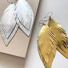 Load image into Gallery viewer, Statement feather leather earrings in silver or gold.