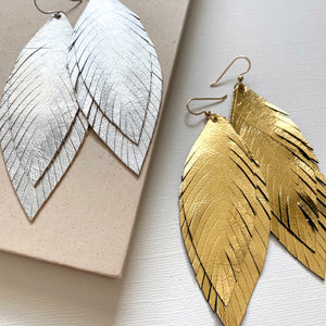 Statement feather leather earrings in silver or gold.