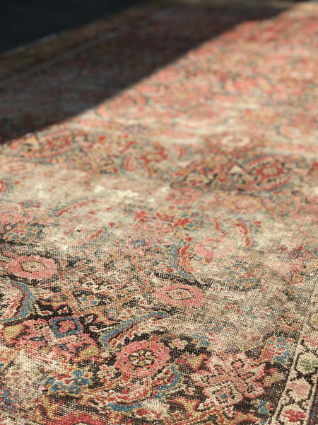 Deliciously threadbare Persian rug