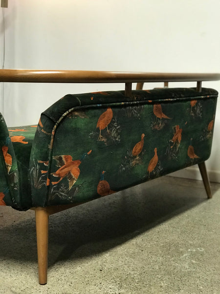 Modern mid-century styled sofa with velvet fabric