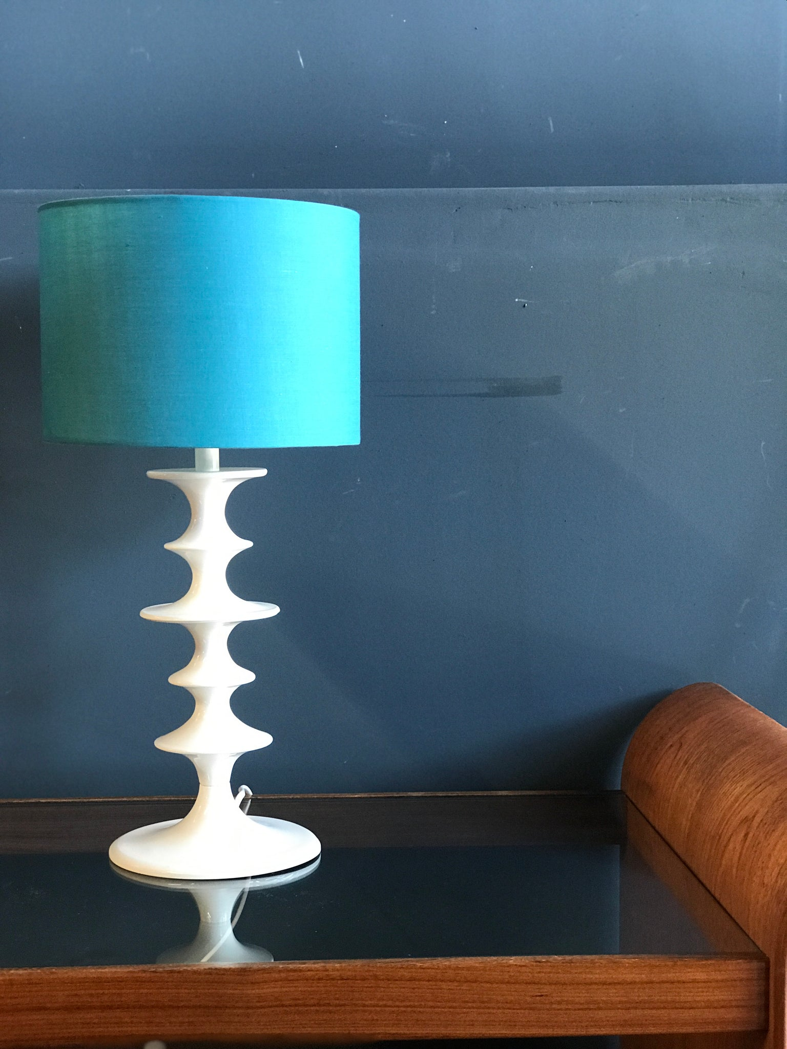 White hooped metal table lamp with blue shade