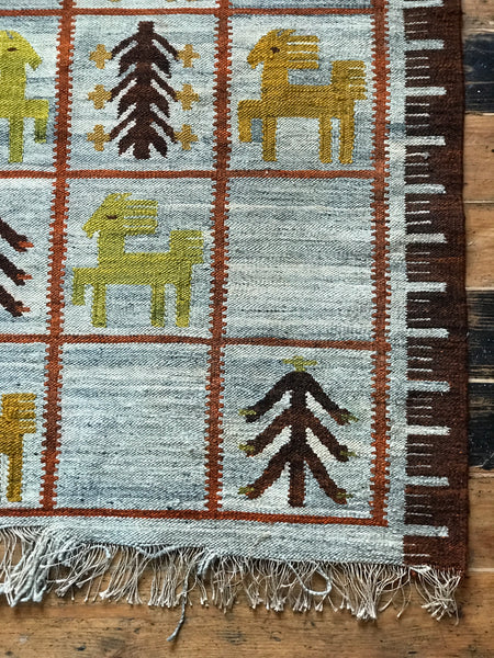 Lovely large vintage wool rug with images of horses and trees