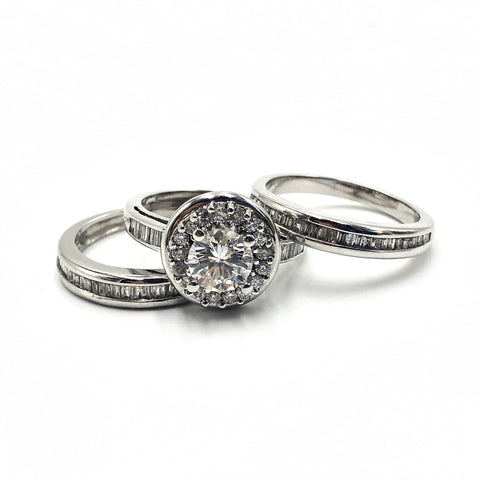 halo engagement ring with baguette wedding bands