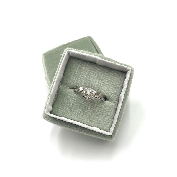 halo engagement ring and wedding band inside velvet box