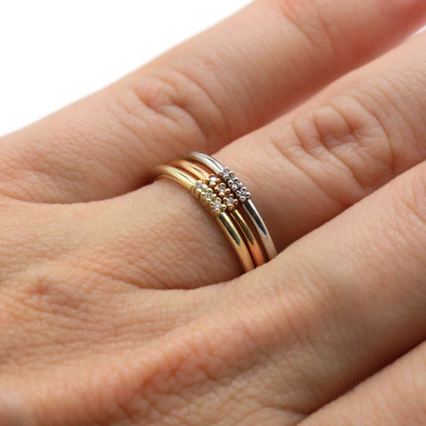 three little diamonds stacking rings in rose, yellow and white gold