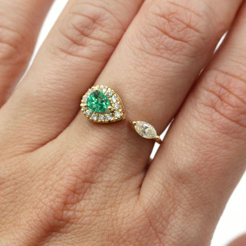 emerald and diamond marquise ring in gold
