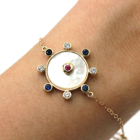 Mother of pearl and gold bracelet with sapphire and rubies