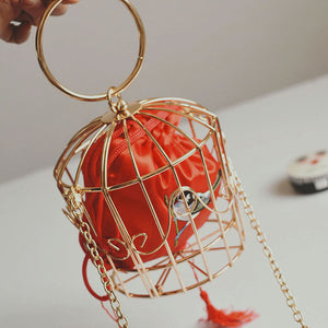 Full of sass Gold Birdcage Bag
