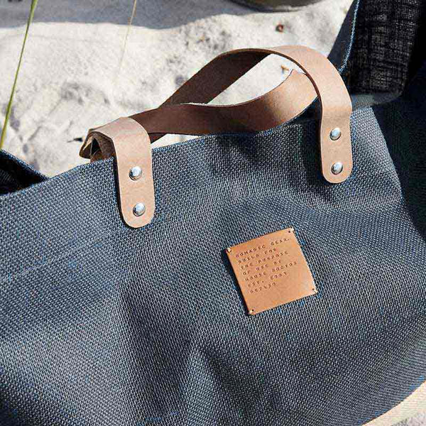 Dark blue Jute Carrie shopping bag from House Doctor leather straps
