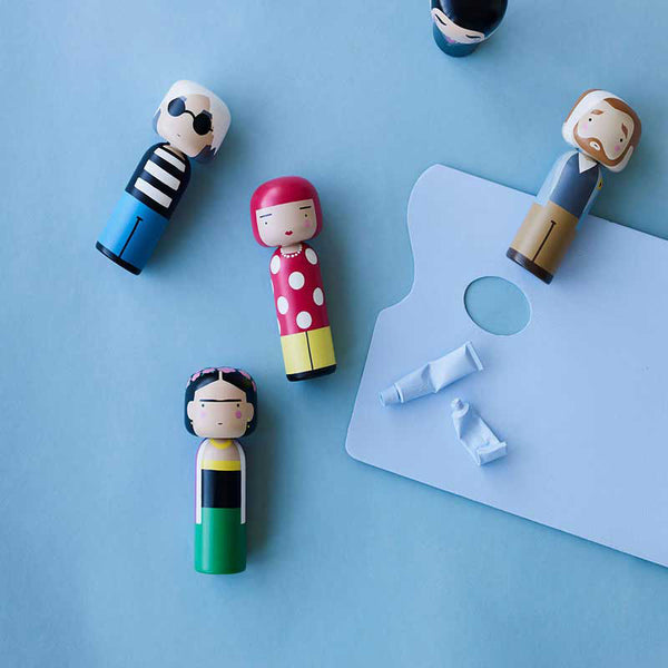 Sketch Inc. for Lucie Kaas modern wooden kokeshi doll as Andy Warhol shown with other dolls Frida and Van Gough